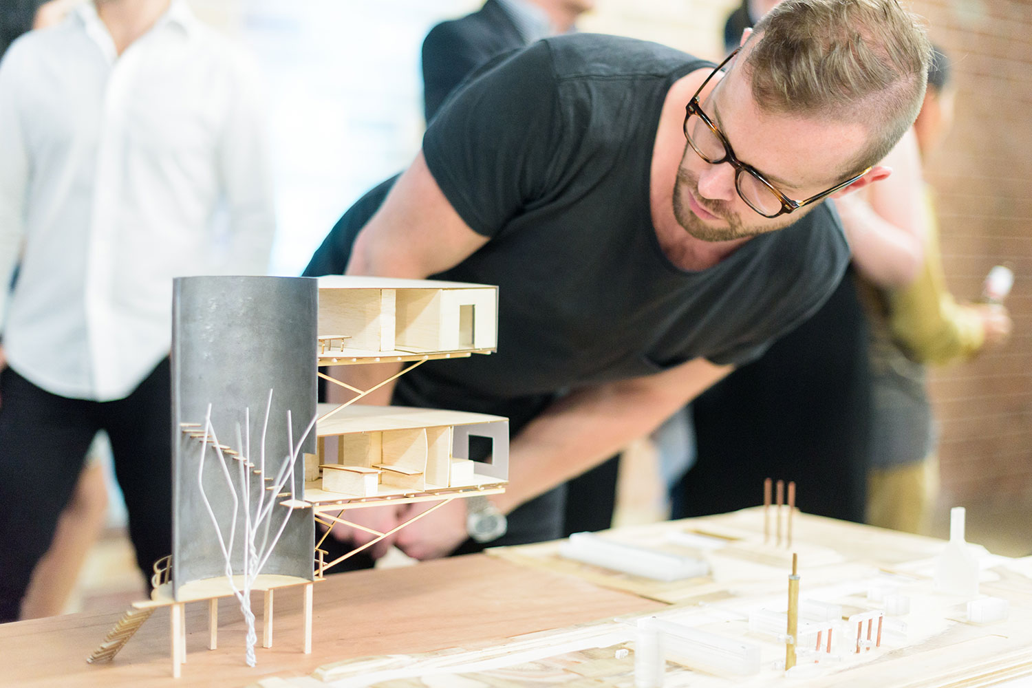 man looks at uts students architectural model