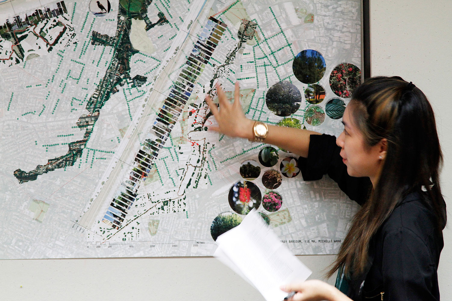 lady in front of landscape plans
