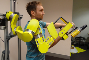 Photo of a prototype of an assistive robotic exoskeleton for abraisive blasting