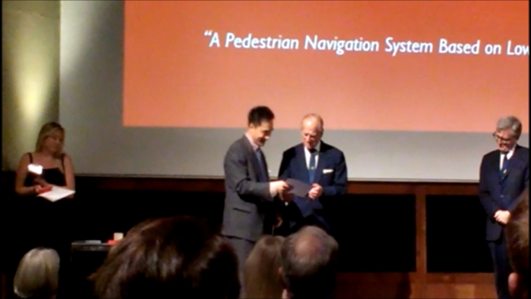 Dr Jianguo (Jack) Wang receiving the Michael Richey Medal, presented by Prince Philip, Duke of Edinburgh..