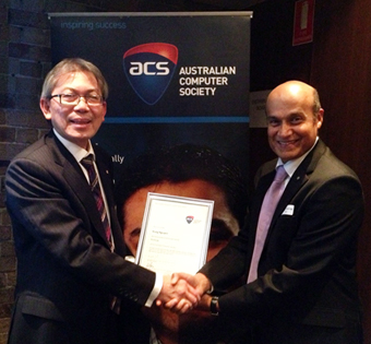 Prof Nguyen being presented with an honorary certificate and silver ACS pin at the August Branch Forum by Murali Sagi, member of the ACS NSW Fellow Committee