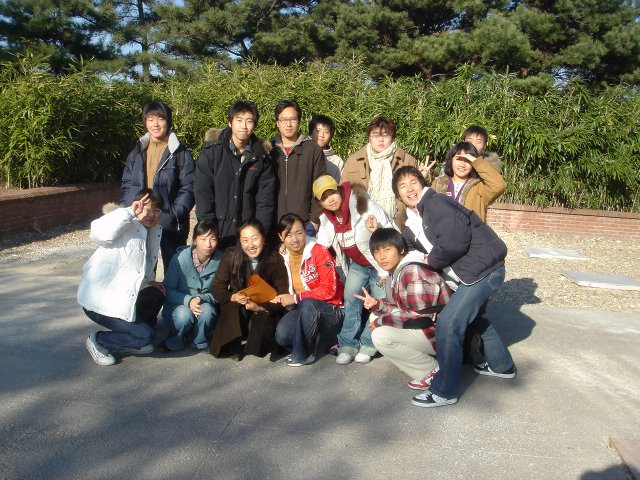 class group of adult students with teacher in Korea