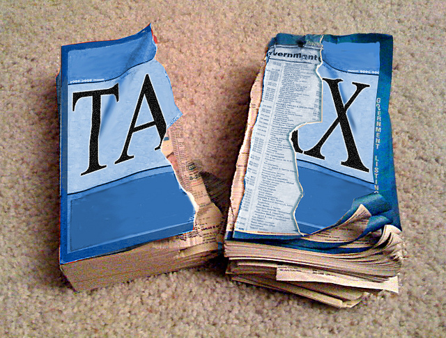 A tax book ripped in half