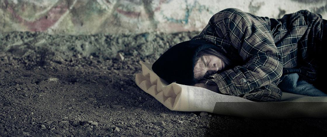 A man sleeping on the street. Image: Thinkstock.