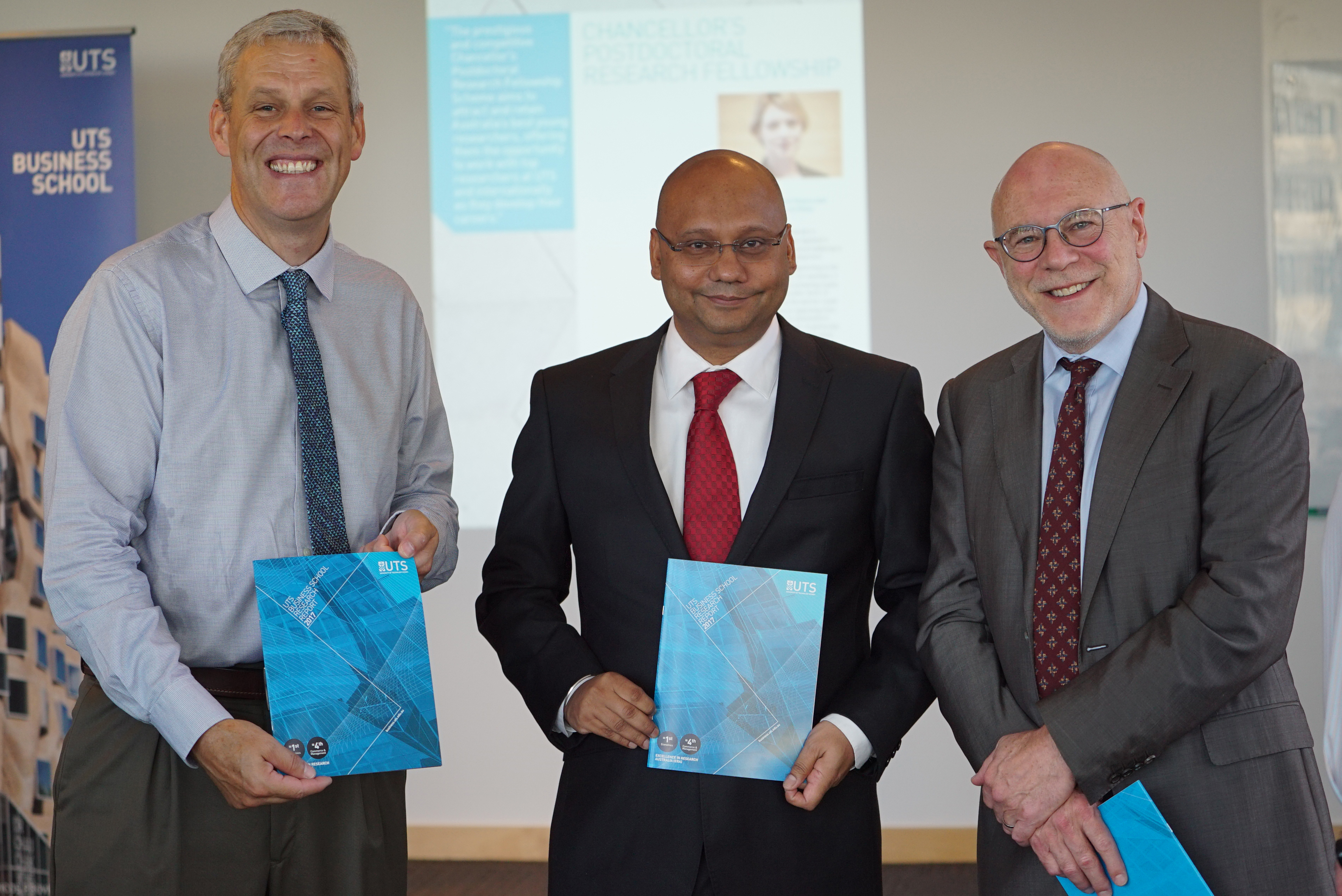 From left, Professor Glenn Wightwick, Professor Ashish Sinha and Professor Roy Green