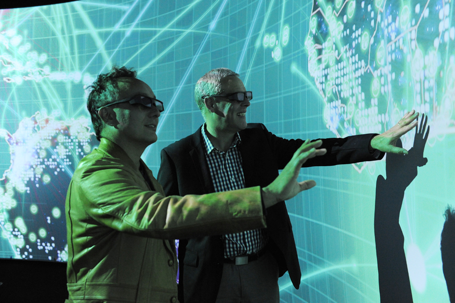 UTS Data Arena, two males with 3D glasses on viewing the 40m of screens in the arena