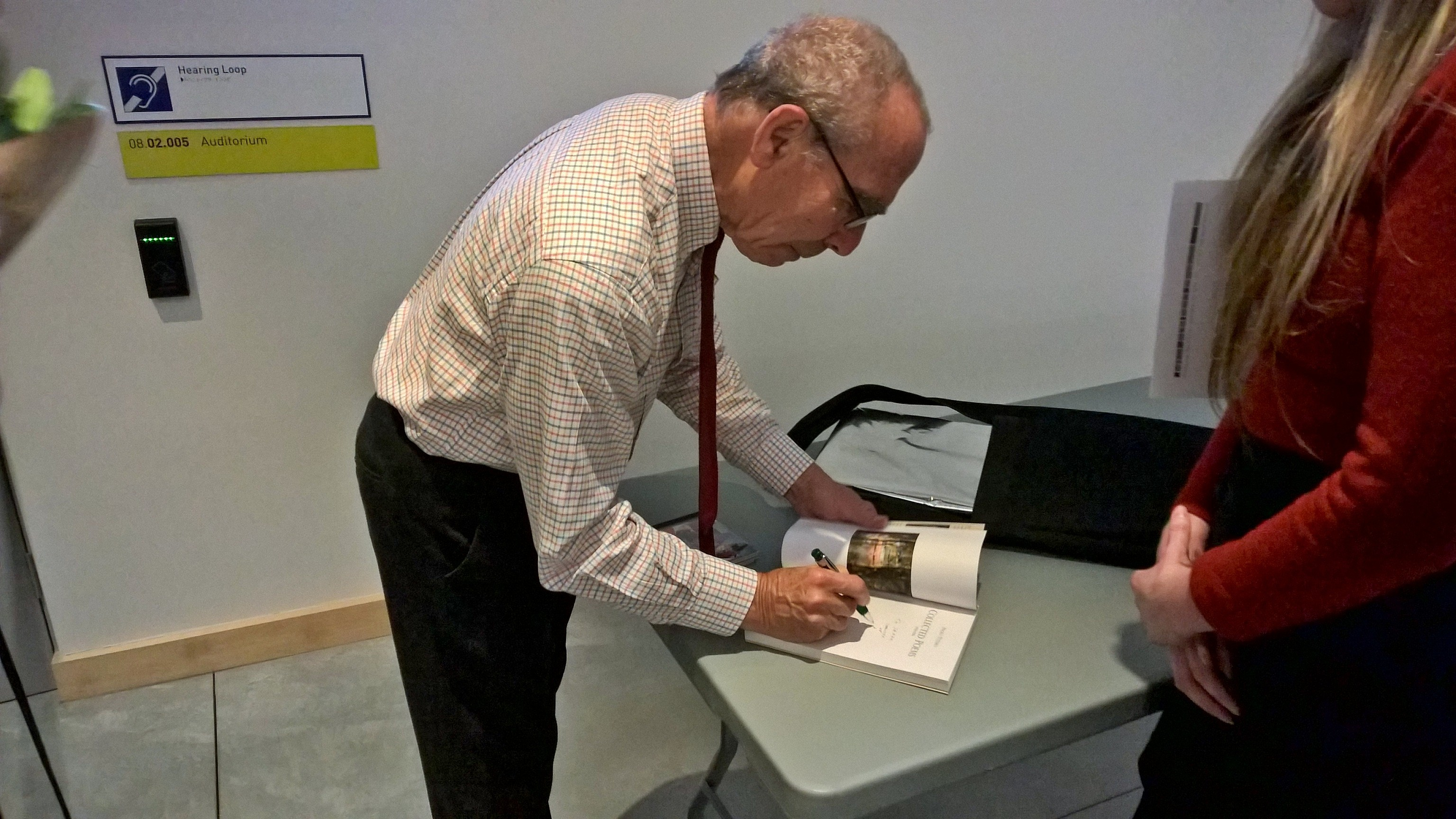 Paolo Totaro signing a program