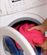loading clothes in washing machine