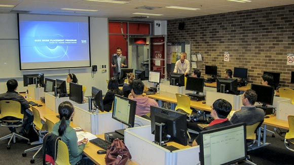 Photo of AAi short course session, with presenter and students in a classroom