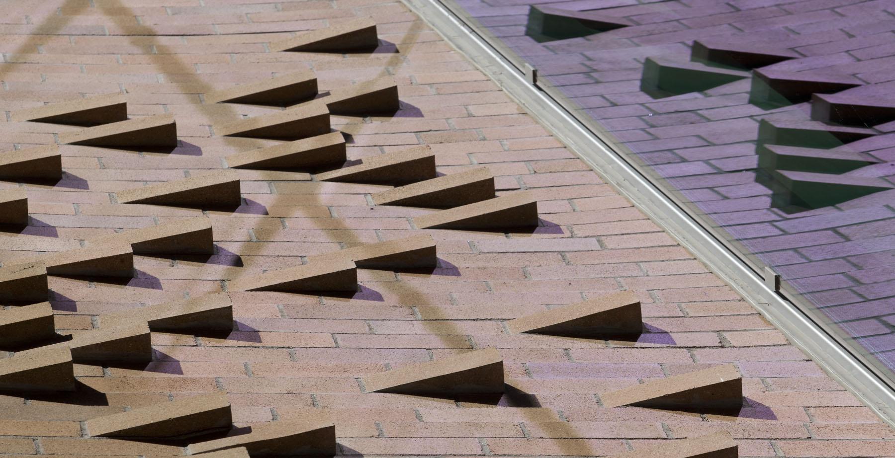Detail photo of 'k-bricks' and undulating brickwork.