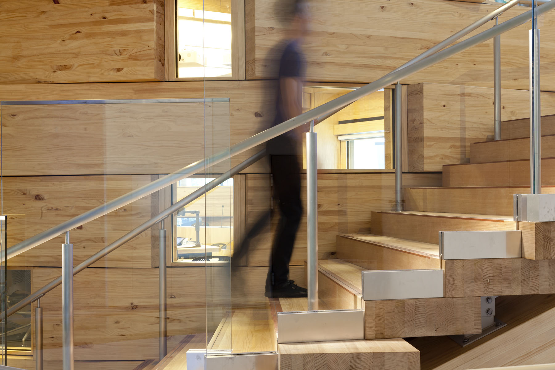 Stair K wraps around the oval classroom on level 3 to the student lounge above on level 4. It is made of Victorian ash.