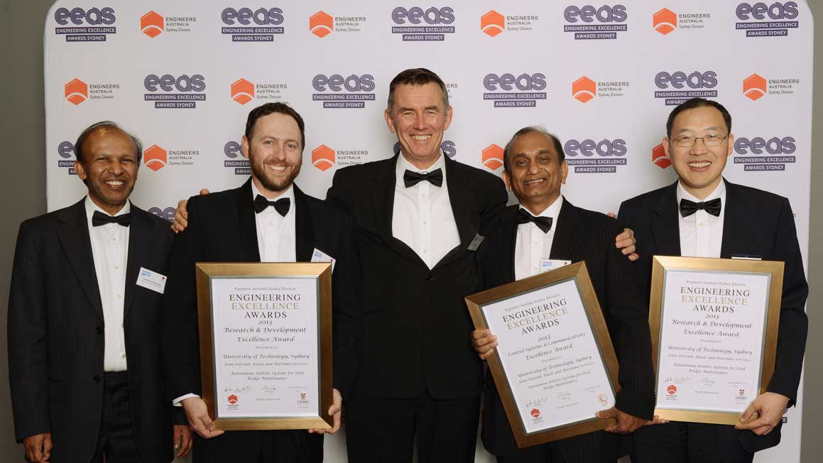 UTS researchers with their awards for the Sydney Harbour Bridge grit-blasting robot