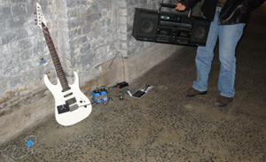 Photo of man with guitar and portable music player