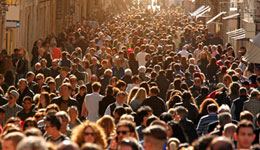 Image of large crowds down a laneway, population health