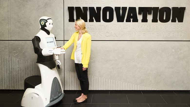 Photo of a woman being greeted by Chip Candroid