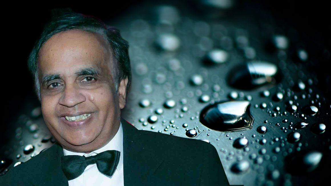 Photo of Saravanamuth Vigneswaran with a background image of water drops