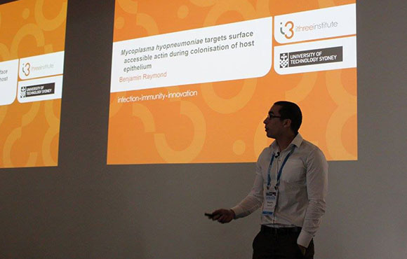 Benjamin Raymond presenting research