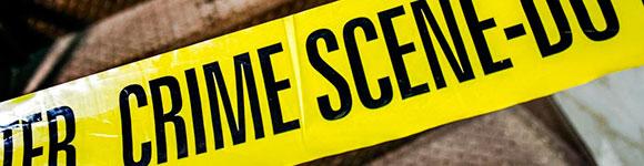 Crime scene written on yellow tape