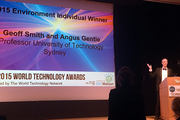 Dr Angus Gentle accepting the 2015 Win World Technology Network Environment Award for roof cooling coating
