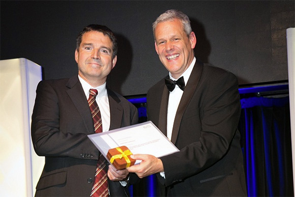 Professor Claude Roux receives the 2015 Deputy Vice-Chancellor's (Research) Medal for Research Impact from Deputy Vice-Chancellor (Research) Professor Glenn Wightwick