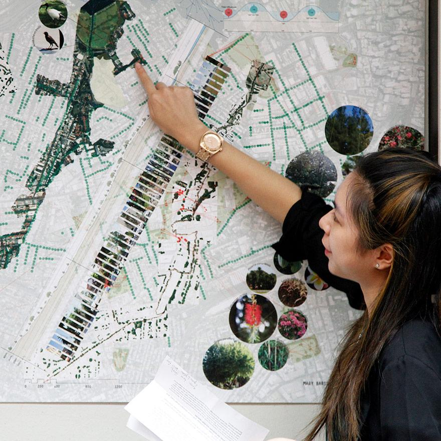 lady pointing to a landscape plan