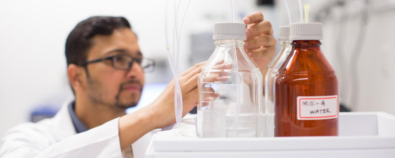 A male researcher working in the lab