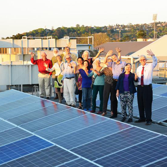 Group photo with solar panels