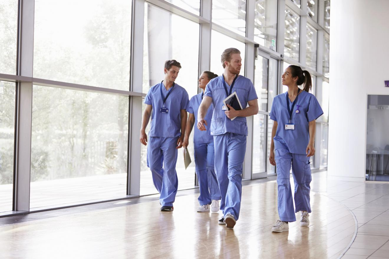 group of nurses walking together