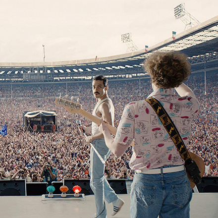 Image of Freddy Mercury on stage from movie Bohemian Rhapsody