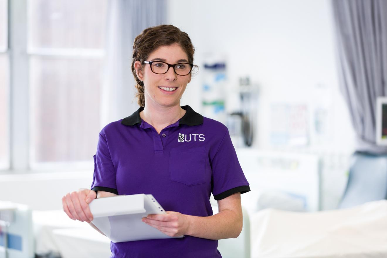 UTS nursing student holding a clipboard