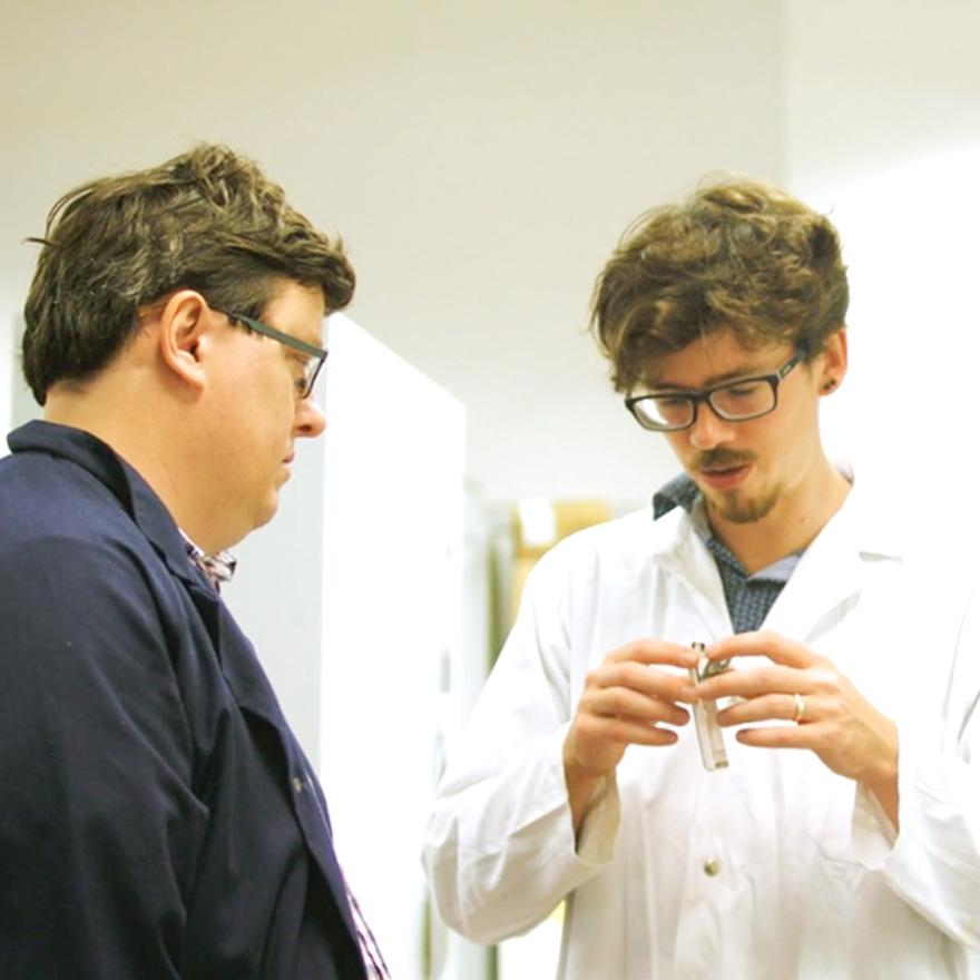 Two men working in a lab