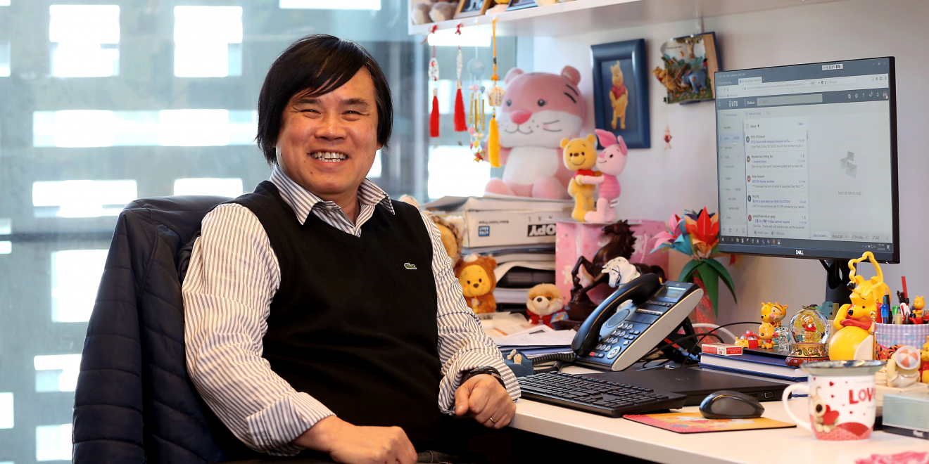 Prof Hao Huu Ngo surrounded by his collection of 'cute things'