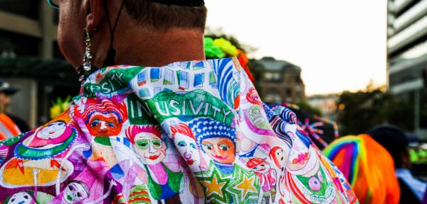 Back view of a person's shirt decorated with diversity and inclusivity images
