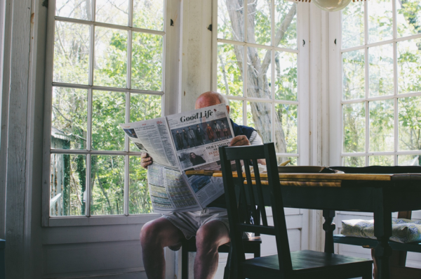 Retiree reading the Good Life newspaper at their home