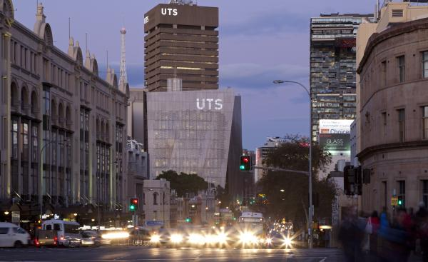 Street level photo of the UTS campus from Broadway (road) showing Building 11 and Building 01 in the dusk