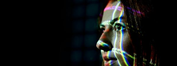 Image of data projected onto the face of a female student