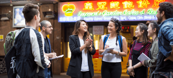 A group of students in Chinatown taking notes