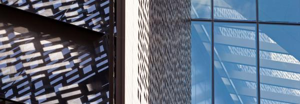 Detail and reflection of the binary facade of the UTS Engineering and IT building and blue sky