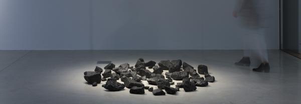 Abstract art piece - black rocks organised on table