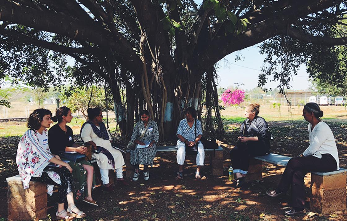 Students sitting under a tree in Bangalore
