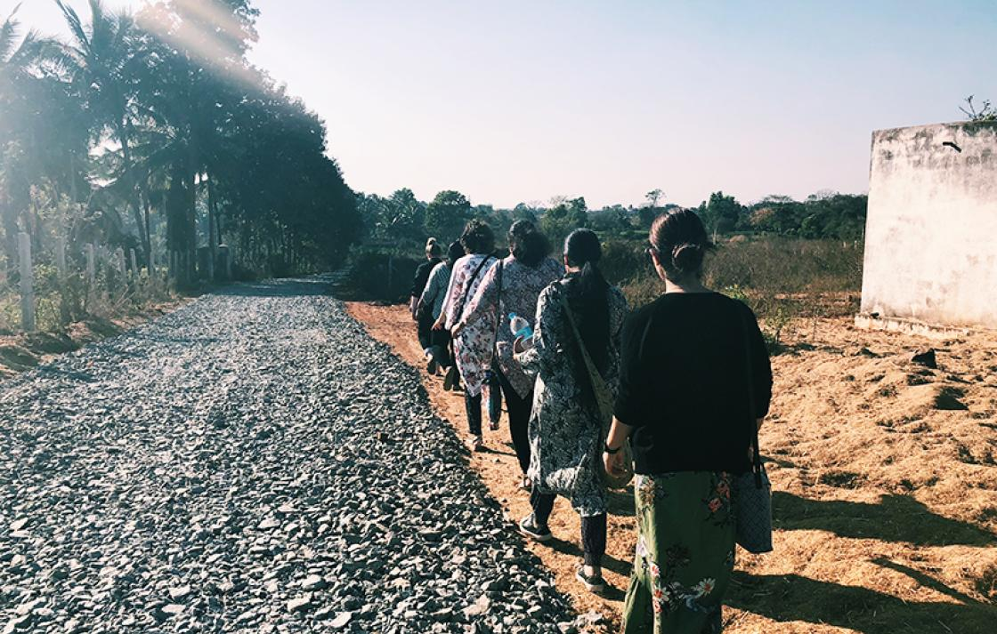 Students and academics walking through a village in Bangalore