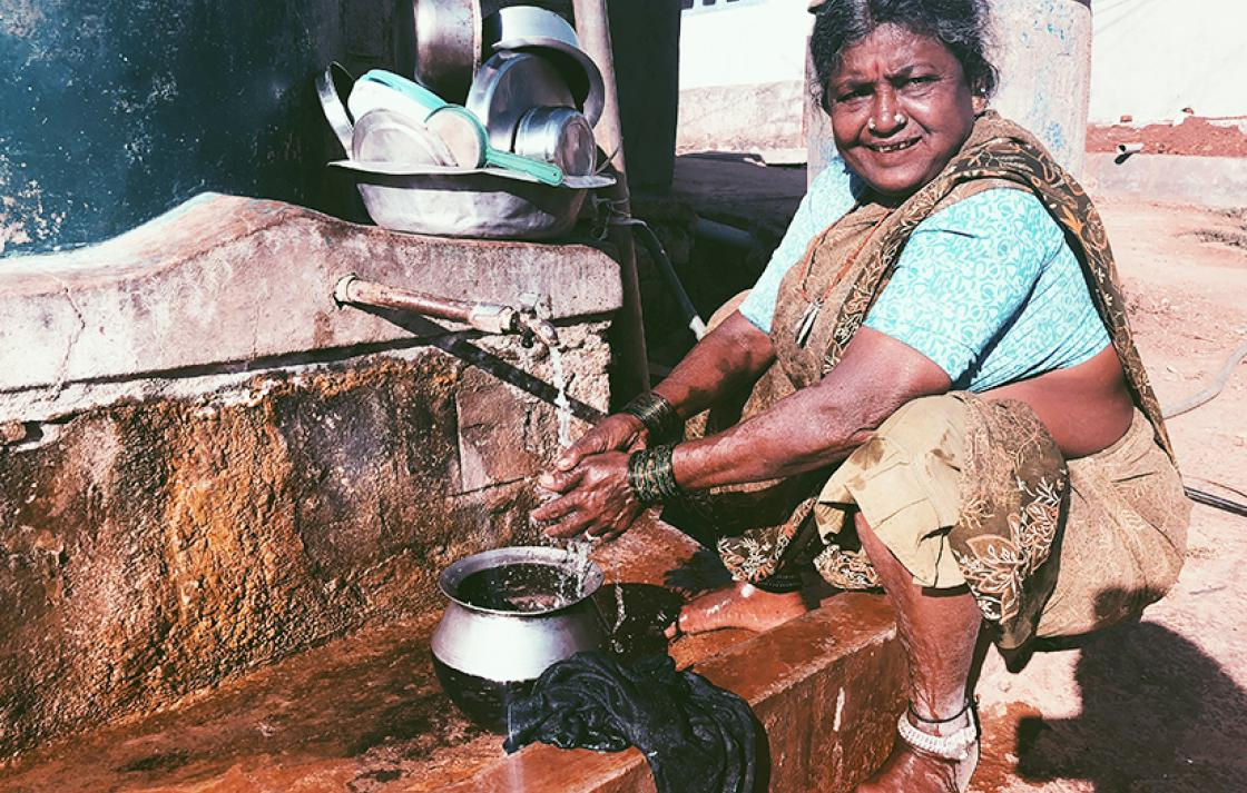 Women washing her hands in village near Bangalore