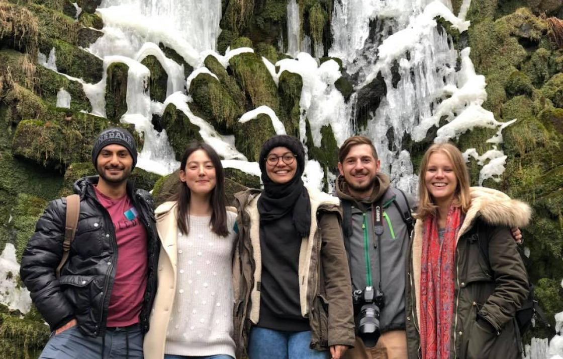 Students in front of a frozen waterfall in Germany