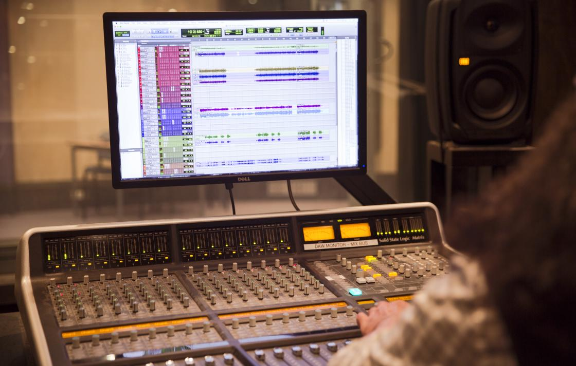 A sound mixing board with Pro Tools running