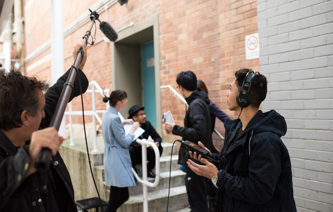 A group of students using sound recording equipment