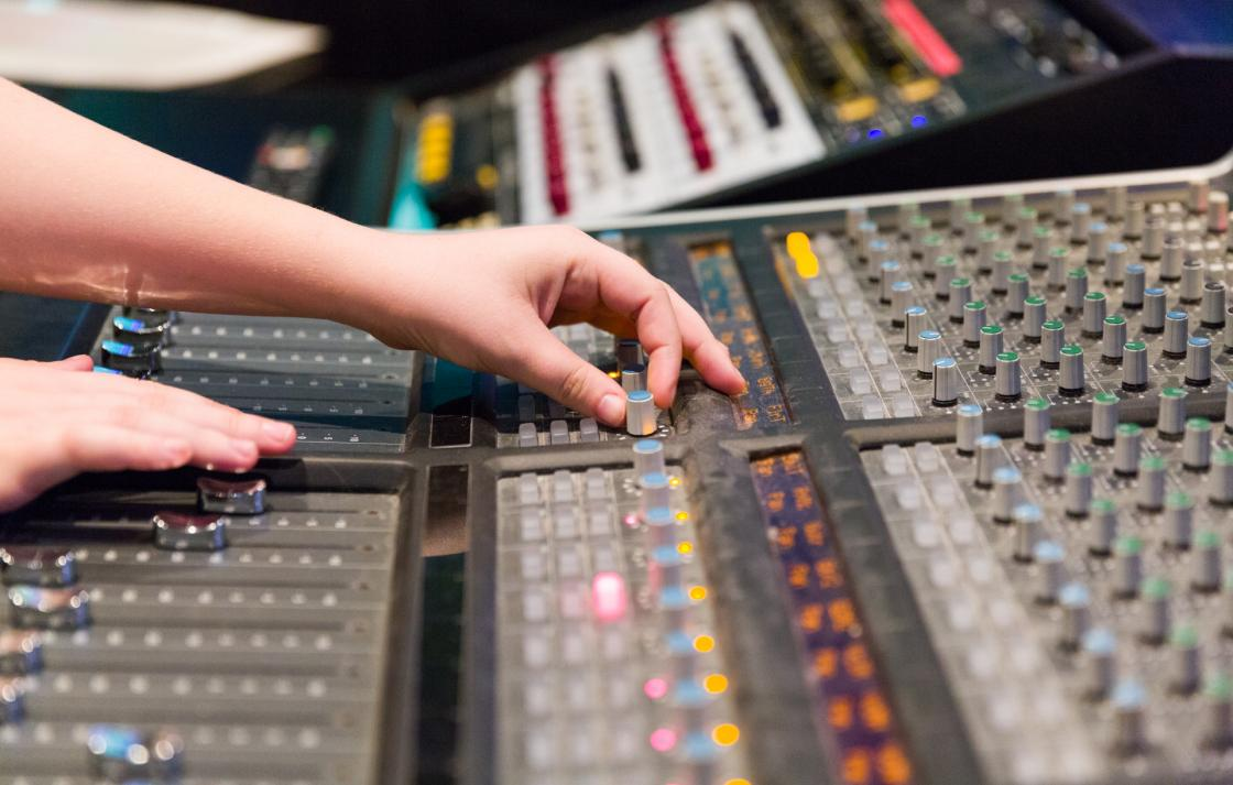Student using a sound mixing console