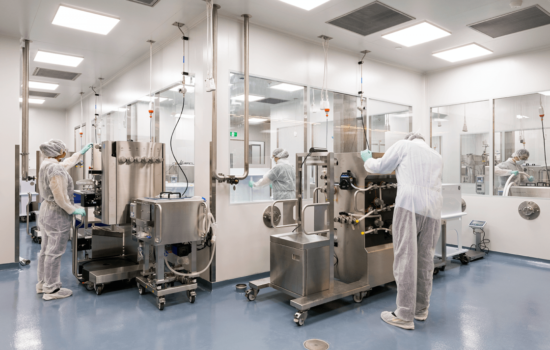 Group of 3 researchers working in the Biologics Innovation Facility (BIF)