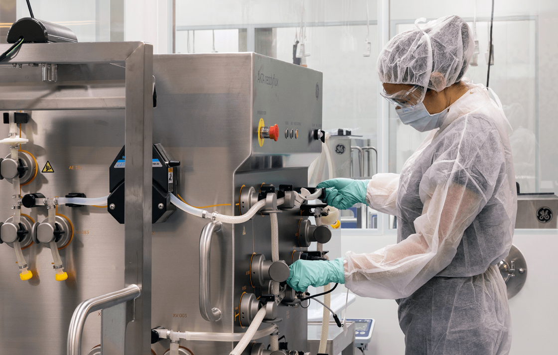 Researcher working with equipment in the Biologics Innovation Facility