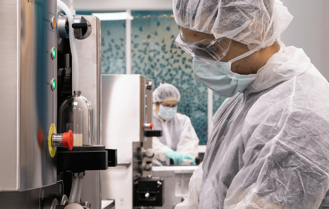 Two researchers working in the Biologics Innovation Facility at UTS