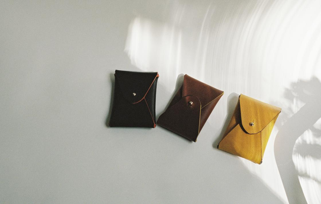 Three small leather purses.